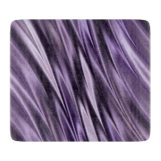 Ondas del negro de la lila tabla para cortar