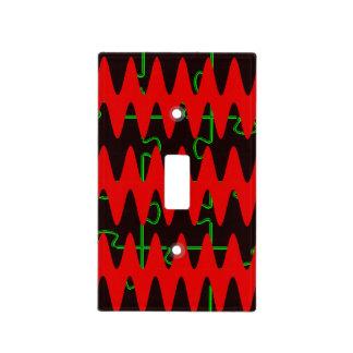 Ondas sinusoidales rojas del rompecabezas cubiertas para interruptor