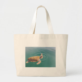 One big swimming sea turtle Caretta Large Tote Bag