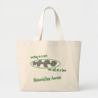 one cell at a time tote bags