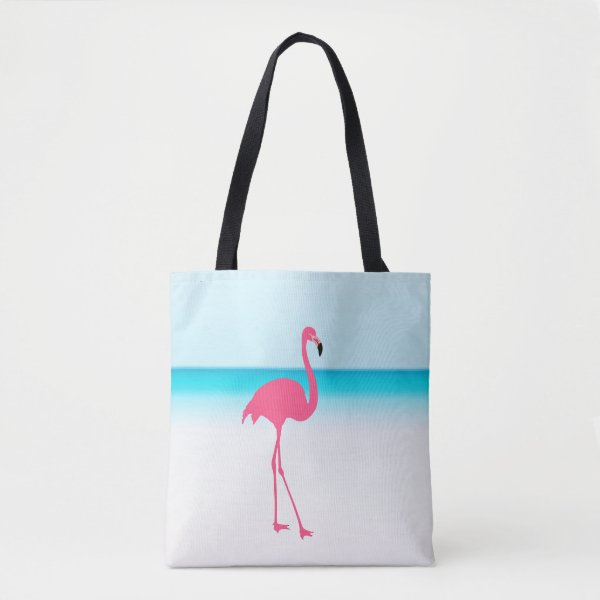 One cute pink flamingo on the beach tote bag