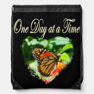 ONE DAY AT A TIME DRAWSTRING BACKPACK