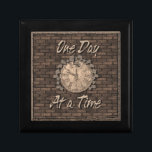 """One Day At A Time God Box medallion box<br><div class=""""desc"""">Beautiful God box featuring an aged stone wall with a clock face covered in vines with the slogan One Day at a Time. One of the most important and loved slogans in the 12 step programs.One day at a time we can be free of our addictions. Perfect for recovery medallions,...</div>"""