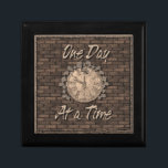 "One Day At A Time God Box medallion box<br><div class=""desc"">Beautiful God box featuring an aged stone wall with a clock face covered in vines with the slogan One Day at a Time. One of the most important and loved slogans in the 12 step programs.One day at a time we can be free of our addictions. Perfect for recovery medallions,...</div>"