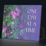 """One Day at a Time Rhododendrons Plaque<br><div class=""""desc"""">One Day at a Time Recovery Slogan over pink Rhododendrons and purple background. Colorful,  harmonious,  nice!</div>"""