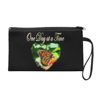 ONE DAY AT A TIME WRISTLET PURSE