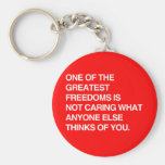 ONE OF THE GREATEST FREEDOMS IS NOT CARING KEYCHAIN