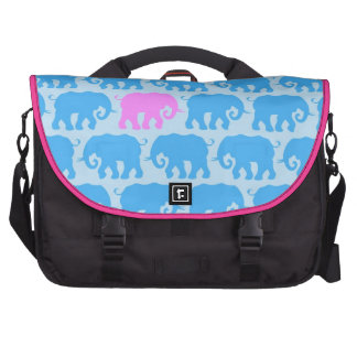 One Pink Elephant in a Herd of Blue Commuter Bags