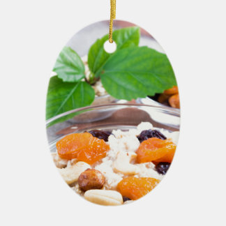 One portion of oatmeal with fruit and berries ceramic ornament