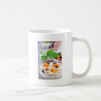 One portion of oatmeal with fruit and berries coffee mug