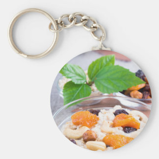 One portion of oatmeal with fruit and berries keychain