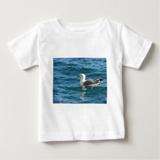 One seagull floating on the sea surface baby T-Shirt