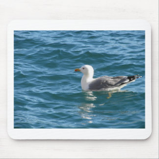 One seagull floating on the sea surface mouse pad