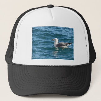One seagull floating on the sea surface trucker hat