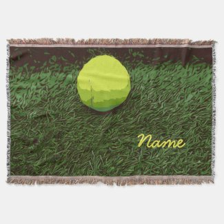 One tennis ball is on green grass throw blanket