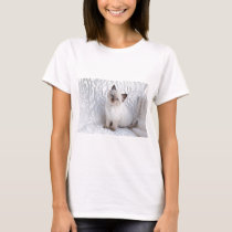 One young ragdoll cat sitting on fur in chair T-Shirt