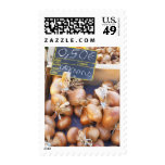 Onions, o.50 euro per bunch, for sale at a postage stamp