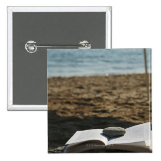 Open book with a roller pinback button