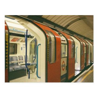 Open gates of a metro train postcard