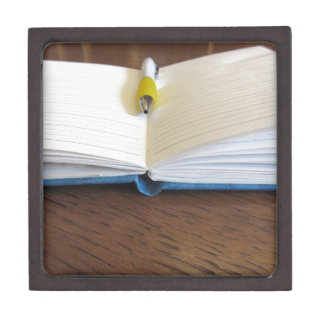 Opened blank lined notebook with pen gift box