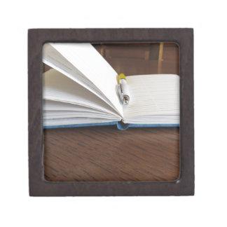 Opened blank lined notebook with pen keepsake box
