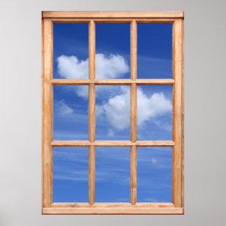 Opinión blanca mullida de las nubes de una ventana poster