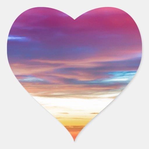 Opinión de la salida del sol de las luces de la pegatina en forma de corazón