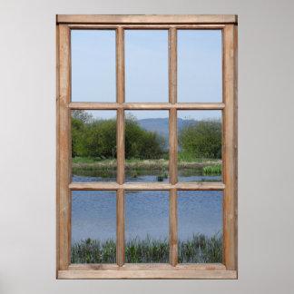 Opinión del lago y de las colinas de una ventana posters