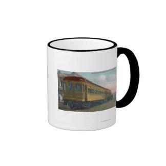 Opinión septentrional de tren eléctrico taza de café