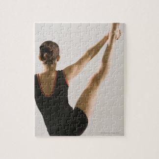 Opinión trasera el gimnasta flexible puzzles