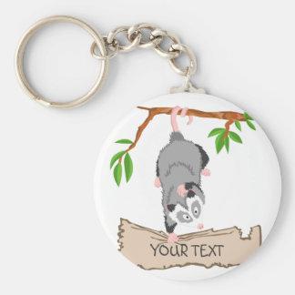 Opossum with sign keychain