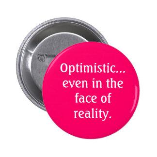 Optimista incluso frente al botón de la realidad pin