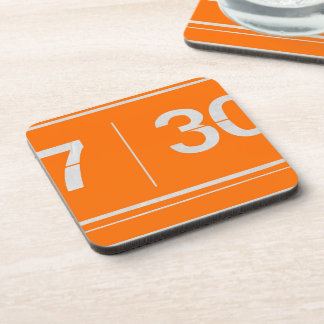 Orange alarm clock drink coaster