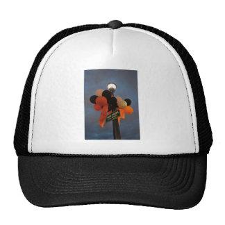 Orange and Black Balloons Adorn a Park Sign Trucker Hat