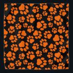 "Orange-and-Black Paw Print Bandana<br><div class=""desc"">This bandana is perfect for Halloween or the Big Game!</div>"