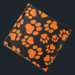 "Orange-and-Black Paw Print Bandana<br><div class=""desc"">This bandana is perfect for Halloween or the Big Game!</div>"