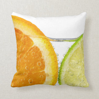 Orange and lime slices in water pillow