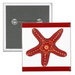 orange and red starfish pin