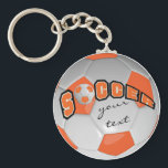 "Orange and White Personalize Soccer Ball Keychain<br><div class=""desc"">Soccer Keychain. When looking straight on at this digital designed orange and white soccer ball, it will give you the realism of a real soccer ball. You can personalize it with your name or any saying you like! More colors are available. 100% Customizable. Ready to Fill in the box(es) or...</div>"