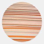 Orange and white stripe design wavy round stickers