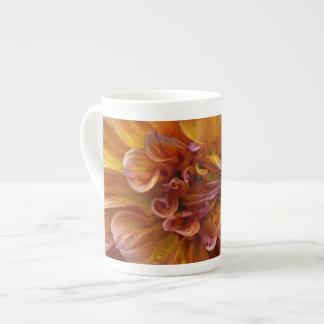 Orange and yellow dahlia flower tea cup