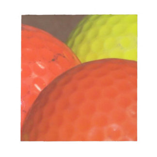 Orange and Yellow Golf Balls Notepad