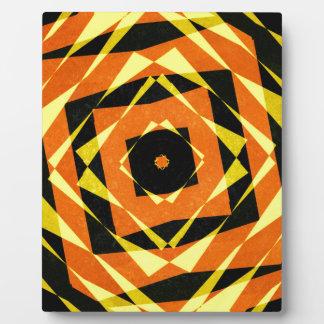 Orange and yellow striped diamond pattern plaque
