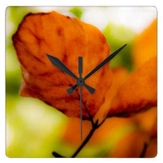 Orange autumn leaves wall clock