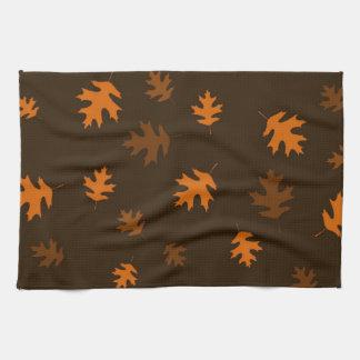 Orange Autumn Oak Leaves Against Dark Brown Kitchen Towel