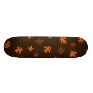 Orange Autumn Oak Leaves Against Dark Brown Skateboard Deck