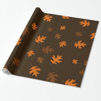 Orange Autumn Oak Leaves Against Dark Brown Wrapping Paper