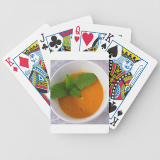 orange banana mango smoothie with green peppermint bicycle playing cards