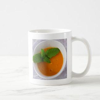 orange banana mango smoothie with green peppermint coffee mug
