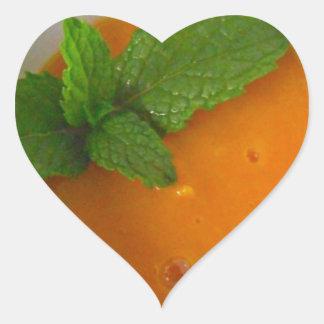 orange banana mango smoothie with green peppermint heart sticker